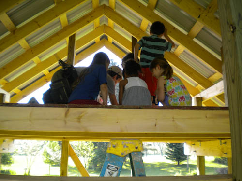 Children helping install the loft floor.